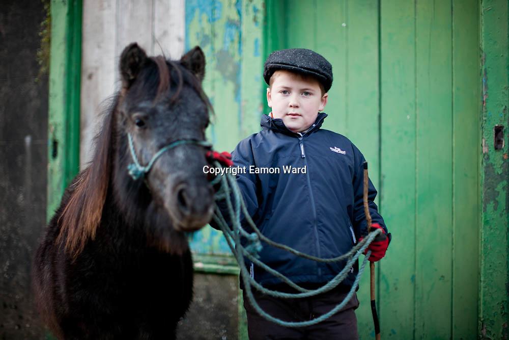 Sean Considine ,Ennistymon with his pony at Ennistymon Horse Fair ,Co Clare.