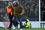 A steward escorts a pitch invader off the pitch. The Emirates FA Cup, 3rd round replay match, Chelsea v Norwich City at Stamford Bridge in London on Wednesday 17th January 2018.<br /> pic by Steffan Bowen, Andrew Orchard sports photography.