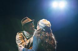 © London News Pictures. Jessica Rose Cambio as Mimi & Sean Pannikar as Rodolfo perform in Puccini's tragic opera La Boheme at The Royal Albert Hall, London on February 26, 2014.   Photo credit: Arnaud Stephenson/LNP