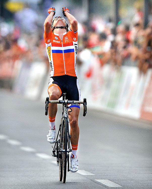 Italy, Florence, 28-09-2013.<br /> Cycling World Championships, Women.<br /> Marianne Vos celebrates her victory far in front of the finish line. Photo: Klaas Jan van der Weij