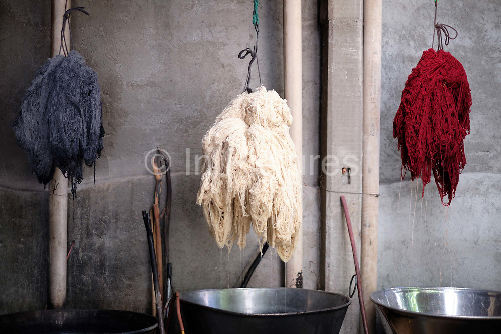 Wool dyed with pomegranate skin grey, wool mordanted with potassium alum and wool dyed with cochineal red in the natural dye studio of Juana Gutierrez Contreras in the Zapotec weaving village of Teotitlan del Valle in Oaxaca, Mexico on 28 November 2018