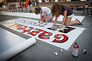 "Two girls write on a banner 'We are young not terrorist' in a place called Aske Gunea (The Free Space in basque language) supporting the 8 young persons who have been sentenced to six years in jail. They have been sentenced for having been members of the Basque pro-independence youth organization SEGI ('Keep on' in basque language). Donostia-San Sebastian (Basque Country) April, 16th 2013. As an arrest warrant was issued against them and they could be arrested any time, young supporters gathered them to prevent them from being arrested. The sentence stated: ""Membership to terrorist organization"". (Gari Garaialde/Bostok Photo)"