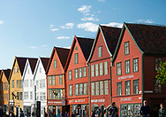 Tourists walking around Bryggen, the old harbour in Bergen, Vestlandet, Norway