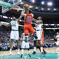 03 February 2013: Los Angeles Clippers power forward Blake Griffin (32) goes to the basket against Boston Celtics center Jason Collins (98) and Boston Celtics power forward Jeff Green (8) during the Boston Celtics 106-104 victory over the Los Angeles Clippers at the TD Garden, Boston, Massachusetts, USA.