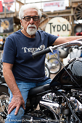 Custom bike builder Mondo Poras at the Iron Horse Saloon during the 78th annual Sturgis Motorcycle Rally. Sturgis, SD. USA. Sunday August 5, 2018. Photography ©2018 Michael Lichter.