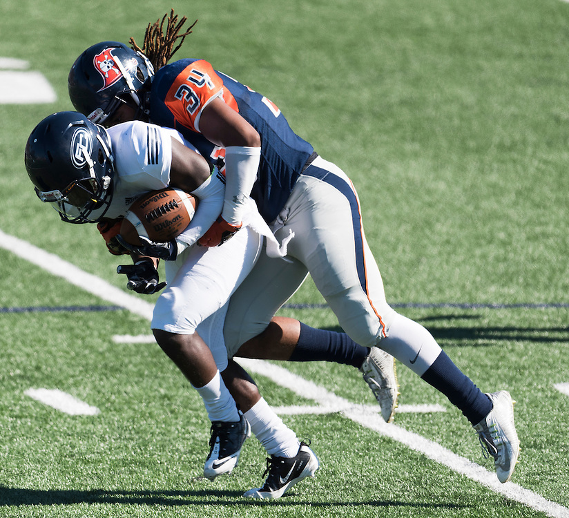 11/5/161:11:43 PM --- Orange Coast Pirate against the Fullerton Hornet<br /> Orange Coast Pirate linebacker Melvin Irby (34) stoping the wide receiver.  <br /> <br /> Photo By Leandro Bernardes, Sport Shooter Academy