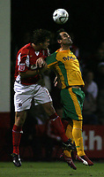 Photo: Paul Thomas.<br /> Rotherham United v Norwich City. Carling Cup. 19/09/2006.<br /> <br /> Ian Sharps (L) of Rotherham battles with Peter Thorrne for the ball.