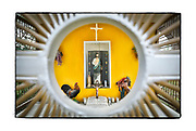SHOT 2/7/18 6:33:46 PM - A brightly colored capilla featuring San Judas Tadeo near El Colorado, Mexico. Judas Thaddaeus (or San Judas Tadeo in Spanish) was one of the Twelve Apostles. A relative of Jesus, he was one of his first followers and after Christ's death, became an evangelizer. Depictions of this saint, especially in Mexico, include a medallion on the chest with Christ's image (representing evangelism), a staff and a hatchet (reminder of martyrdom). Petitions often include help with personal problems, legal problems, work issues and family. He is also invoked to help find lost objects. Capillas are common along the roads and highways of Mexico which is heavily Catholic and are often dedicated to certain patron saints or to the memory of a loved one that has passed away. Often times they contain prayer candles, pictures, personal artifacts or notes. (Photo by Marc Piscotty / © 2018)