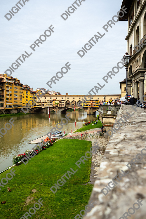 Ponte Vecchio -bridge- over the Arno river located in Florence, Tuscany region- Italy.  Vertical Image.