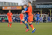 AFC Wimbledon attacker Shane McLoughlin (38) battles for possession with Millwall defender Jake Cooper (5) during the The FA Cup 5th round match between AFC Wimbledon and Millwall at the Cherry Red Records Stadium, Kingston, England on 16 February 2019.