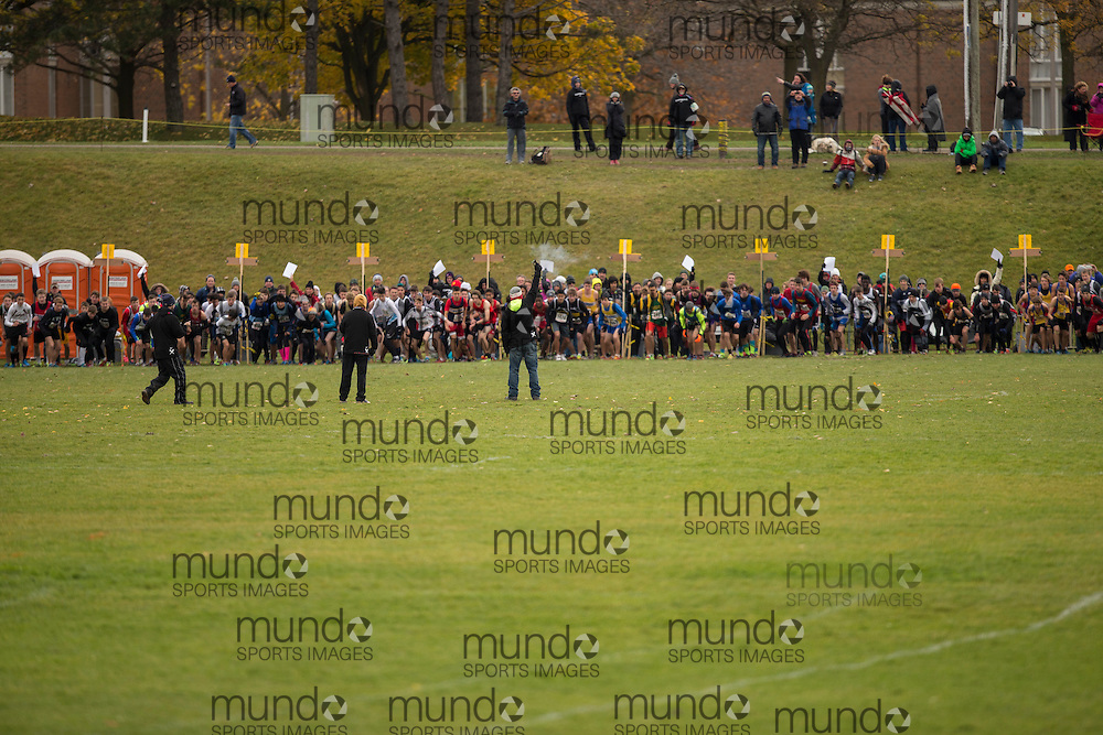The pack heads out on the course at start of the Junior Boys race at the OFSAA Cross Country Championships in Waterloo Ontario, Saturday, November 1, 2014.<br /> Mundo Sport Images/ Geoff Robins