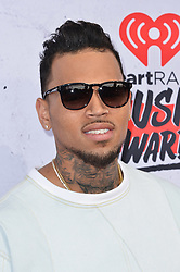 File photo - Chris Brown attends the iHeartRadio Music Awards at The Forum on April 3, 2016 in Los Angeles, CA, USA. US singer Chris Brown was arrested in Paris yesterday morning January 21, 2019, with two other people on suspicion of rape, a French police source said. Three men had been detained after a 24-year-old woman alleged she was raped at Brown's hotel suite on the night of January 15, 2019. Photo by Lionel Hahn/ABACAPRESS.COM