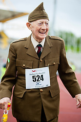 Sheffield Half Marathon Fun Run Sunday Morning.At over 80 years old the Oldest marathon runner in the sheffield event takes finishes the fun run with a smile..12 May 2013.Image © Paul David Drabble