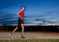 Augusta, New Jersey - A man runs at night during the 3 Days at the Fair races at Sussex County Fairgrounds on May 12, 2012.