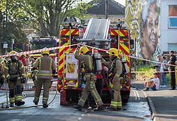 © Licensed to London News Pictures; 11/04/2020; Bristol, UK. Avon Fire and Rescue Service and police attend a fire at the St Pauls Adventure Playground on the Saturday evening of the Easter weekend during the coronavirus lockdown. The fire damaged the wooden climbing frame and blackened the tree in the playground which is closed due to the coronavirus pandemic. The cause is not yet known. Photo credit: Simon Chapman/LNP.