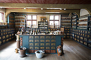 Pharmacy / apothecary interior at Den Gamle By, The Old Town, open-air folk museum at Aarhus,  East Jutland, Denmark
