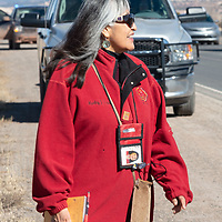 Marley Shebala walking along Indian Route 12 during the Missing and Murdered Indigenous Women and Girls Walk in Window Rock Friday.