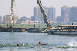 July 21, 2017 - El-Warraq, Egypt - Boys swim in the Nile River next to the El-Warraq island, Egypt, on July 21, 2017. (Credit Image: © Fayed El-Geziry/NurPhoto via ZUMA Press)