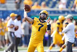Oct 6, 2018; Morgantown, WV, USA; West Virginia Mountaineers quarterback Will Grier (7) warms up prior to their game against the Kansas Jayhawks at Mountaineer Field at Milan Puskar Stadium. Mandatory Credit: Ben Queen-USA TODAY Sports