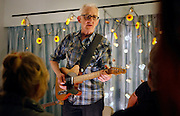 BILL KIRCHEN, formerly with the band Commander Cody, plays Hot Rod Lincoln for an intimate crowd at the 28th Annual Folk Alliance International conference which was held in Kansas City over the weekend. Folk artist from all over the world come to showcase their talent to the industry.