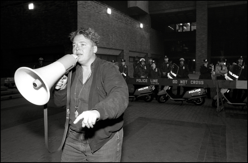 Gerri Wells of ACT UP/Queer Nation speaks to the crowd on October 25, 1990, when nearly 200 members of the GLBTQ community rallied outside the Police Department's Headquarters accusing the city of failing to counter anti-gay violence.