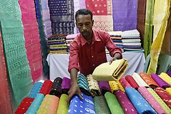 June 17, 2017 - Dhaka, Bangladesh - A shopkeeper is arranging jamdani saree, at a Jamdani Saree Fair for coming of Eid at National Museum, Dhaka. Jamdani are harming the reputation of the traditional of Bangladesh. (Credit Image: © Md. Mehedi Hasan/Pacific Press via ZUMA Wire)