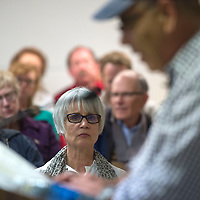 """Patrice Olson, an english teacher from Wingate High School, sits in the front row listening to Jimmy Santiago Baca read his poem, """"Rita falling from the sky"""" during the kick off event for the 2016 Gallup Author's Festival at Octavia Fellin Library in Gallup Friday. Olson taught a unit of Baca's poems and had some of her students come out to meet him at the reading."""