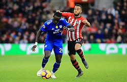 Southampton's Ryan Bertrand (right) and Cardiff City's Oumar Niasse battle for the ball during the Premier League match at St Mary's Stadium, Southampton.
