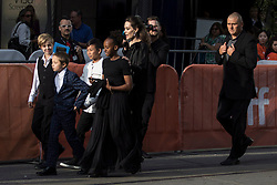 """Director Angelina Jolie shepherds her children towards the theatre as they arrive for the screening of """"First They Killed My Father"""" at the Toronto International Film Festival in Toronto, ON, Canada, on Monday, September 11, 2017. Photo by Chris Young/CP/ABACAPRESS.COM"""