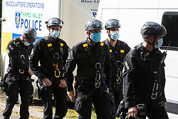 Thames Valley Police officers with face coverings and climbing gear prepare to arrest two anti-HS2 activists who had blocked a HGV used for works connected to the HS2 high-speed rail link on 28 September 2020 in Denham, United Kingdom. Environmental activists continue to try to prevent or delay works on the controversial £106bn project for which the construction phase was announced on 4th September from a series of protection camps based along the route of the line between London and Birmingham.