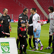Referee's Bunyamin GEZER (C) and Trabzonspor's Umut BULUT (C) during their Turkish superleague soccer derby match Galatasaray between Trabzonspor at the TT Arena in Istanbul Turkey on Sunday, 10 April 2011. Photo by TURKPIX