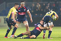 Adam Siddall (C) of USA tries to stop Dorin Manole (R) of Romania during their  rugby test match between Romania and USA, on National Stadium Arc de Triomphe in Bucharest, November 8, 2014.  Romania lose the match against USA, final score 17-27.