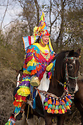 A woman reveler on horseback during the traditional Cajun Courir de Mardi Gras chicken run on Fat Tuesday February 17, 2015 in Eunice, Louisiana. Cajun Mardi Gras involves costumed revelers competing to catch a live chicken as they move from house to house throughout the rural community and women are rarely allowed to participate.