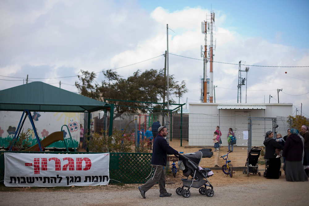 Jewish settlers are seen at the unauthorized West Bank outpost of Migron, on January 17, 2012. Israel's Supreme Court ordered the evacuation of Migron, the largest outpost in the West Bank, built on private Palestinian land, by March 2012.