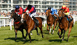 Call to Mind ridden by Ryan Moore wins the Dubai Duty Free Tennis Championships Maiden Stakes during day two of the Dubai Duty Free Spring Trials & Beer Festival at Newbury Racecourse.
