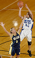 Times Herald-Record/TOM BUSHEY.Oneisha Staples, right, of Mount Saint Mary takes a shot over Alexa Shields of the College of New Jersey during the second half of a game last night in Newburgh..Feb. 18, 2005..