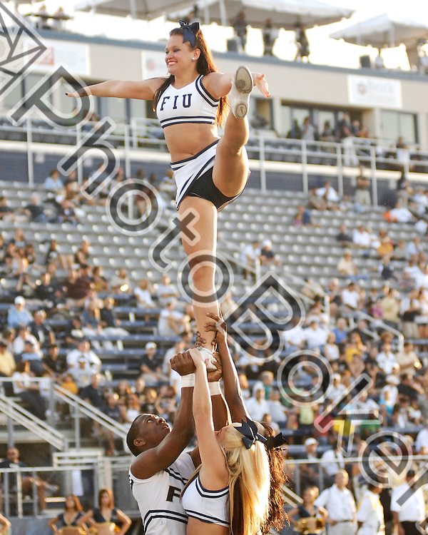 2010 October 09 - Florida International University cheerleaders performing for the fans, Miami, Florida. (Photo by: www.photobokeh.com / Alex J. Hernandez) This image is copyright PhotoBokeh.com and may not be reproduced or retransmitted without express written consent of PhotoBokeh.com. ©2012 PhotoBokeh.com - All Rights Reserved