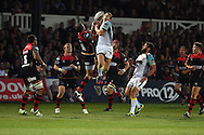 Dan Biggar  of the Ospreys © jumps for a high ball with Lee Byrne of the Dragons. Guinness Pro12 rugby union, Newport Gwent Dragons v Ospreys at Rodney Parade in Newport, South Wales on Friday 12th Sept 2014<br /> pic by Andrew Orchard, Andrew Orchard sports photography.