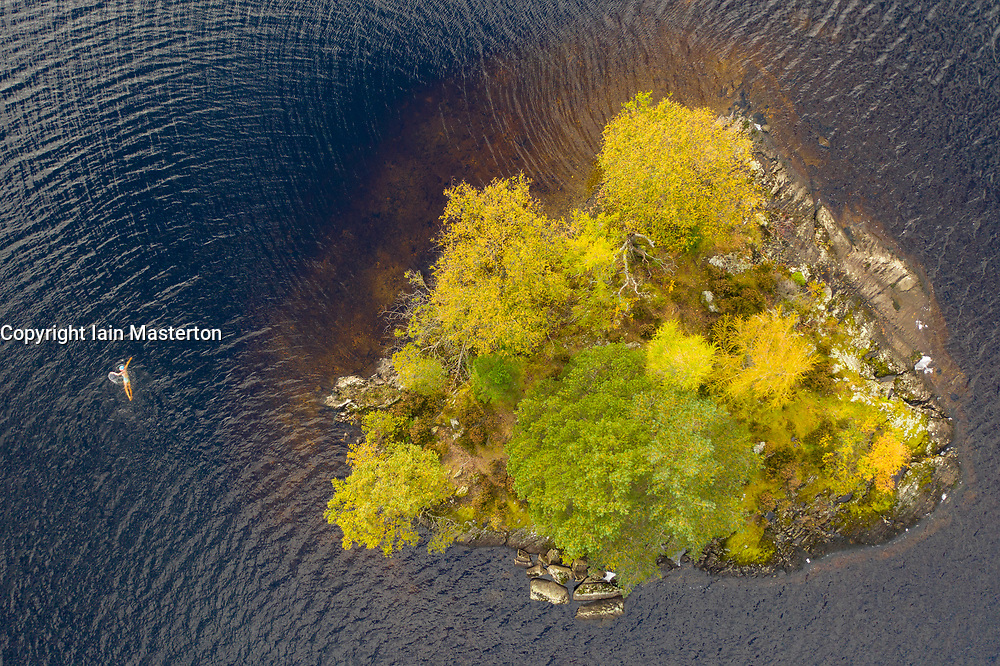 Aberfoyle, Scotland, UK. 10 October 2020. Meg Spittal ,,a wild swimmer with the Fife Wild Swimming group enjoys a bracing autumnal swim around a small tree covered island in the middle of Loch Chon in Loch Lomond and Trossachs National Park.  Iain Masterton/Alamy Live News
