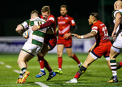 James Cordy Redden of Ealing Trailfinders is tackled by Ian Madigan of Bristol Rugby - Rogan/JMP - 10/02/2018 - RUGBY UNION - Trailfinders Sports Ground - Ealing Trailfinders v Bristol Rugby - Greene King IPA Championship.