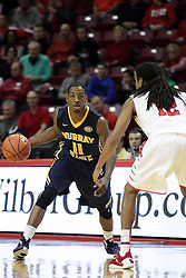 13 December 2015:  Damarcus Croaker(11) continues his dribble as he is approached by Tony Wills(12).  Illinois State Redbirds host the Murray State Racers at Redbird Arena in Normal Illinois (Photo by Alan Look)