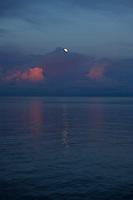 Setting full moon over Wasile Bay, Halmahera.
