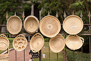 Sweet grass baskets on display along an ironwork fence on Meeting Street June 28, 2014 in Charleston, SC. Sweet grass basketmaking was brought to the area by African slaves and continues as a traditional craft.