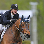 NORTH SALEM, NEW YORK - May 15: McLain Ward, USA, riding HH Carlos Z, in action while winning The $50,000 Old Salem Farm Grand Prix presented by The Kincade Group at the Old Salem Farm Spring Horse Show on May 15, 2016 in North Salem. (Photo by Tim Clayton/Corbis via Getty Images)