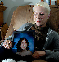 Holly Sherman poses with a picture of her daughter, Leslie Sherman, a year after Leslie was killed at Virginia Tech. Leslie Sherman was one of 32 people killed April 16, 2007 in what was the deadliest campus shooting in the U.S.