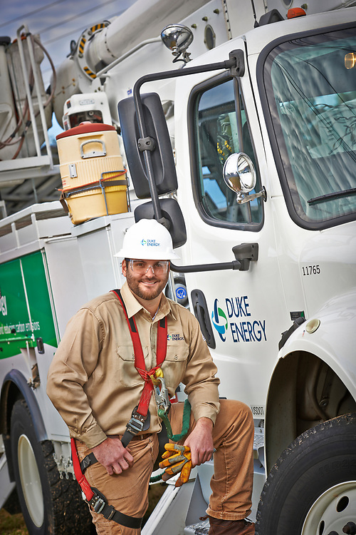 Portrait of Duke Energy lineman beside newly branded truck
