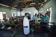 Batak Christian church prayer on Sunday..Batak Indigenous Christian people living on Samosir Island and nearby Lake Toba in Indonesia. There are some 6 million Christian Batak in Indonesia, the world's largest Muslim country of 237 million people, which has more Muslims than any other in the world. Though it has a long history of religious tolerance, a small extremist fringe of Muslims have been more vocal and violent towards Christians in recent years. ..Batak religion is found among the Batak societies around Lake Toba in north Sumatra. It is ethnically diverse, syncretic, liable to change, and linked with village organisations and the monotheistic Indonesian culture. Toba Batak houses are boat-shaped with intricately carved gables and upsweeping roof ridges, and Karo Batak houses rise up in tiers. Both are built on piles and are derived from an ancient Dong-Son model. The gable ends of traditional houses, Rumah Bolon or Jabu, are richly decorated with the cosmic serpent Naga Padoha carved in wood or in mosaic, lizards, double spirals, female breasts, and the head of the singa, a monster with protruding eyes that is part human, part water buffalo, and part crocodile or lizard. The layout of the village symbolises the Batak cosmos. They cultivate irrigated rice and vegetables. Irrigated rice cultivation can support a large population, and the Toba and the Karo live in densely clustered villages, which are limited to around ten homes to save farming land. The kinship system is based on marriage alliances linking lineages of patrilineal clans called marga. In the 1820's Islam came to the southern Angkola and Mandailing homelands, and in the 1850's and 1860's Christianity arrived in the Angkola and Toba region with Dutch missionaries and the German Rheinische Mission Gesellschaft. The first German missionary caused the Dutch to stop Batak communal sacrificial rituals and music, which was a major blow to the traditional religion. Dutch colonial policy favoured Christia
