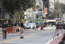 NEW YORK, Sept. 18, 2016 (Xinhua) -- FBI investigators are seen at the blast site in New York, U.S., Sept. 18, 2016. All 29 people wounded in Saturday's blast in New York City were released from hospitals, Mayor Bill de Blasio said Sunday at a news conference on the explosion. (Xinhua/Wang Ying) (Credit Image: © Wang Ying/Xinhua via ZUMA Wire)