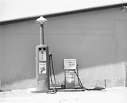 two old fashioned gasoline pumps