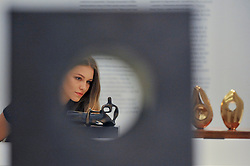 """© Licensed to London News Pictures. 15/06/2017. London, UK. A staff member views a """"Reclining Figure"""", 1959, by Henry Moore (estimate GBP250-350k). Preview of Impressionist and Modern art sale, which will take place at Sotheby's New Bond Street on 21 June.  Photo credit : Stephen Chung/LNP"""